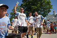 Winnipesaukee Muskrats baseball team hands out tickets to the crowd as they marched in the Gilmanton 4th of July parade Tuesday morning.  (Karen Bobotas/for the Laconia Daily Sun)