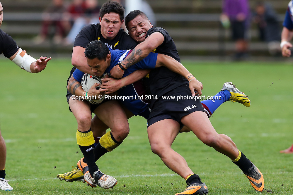 \AF5 is brought to ground during NZRL Pirtek National Premiership Rugby League match, Akarana Falcons v Wellington Orcas at Ellerslie Domain, Ellerslie, Auckland, New Zealand. Saturday  13 September 2014.