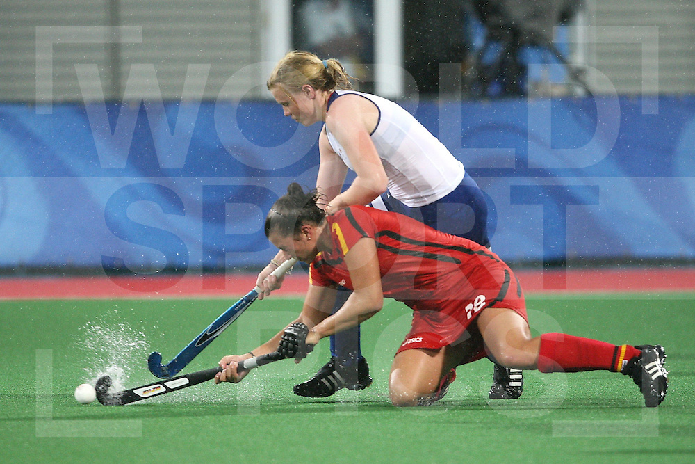..Charlotte Craddock of Great Britain (above) battles with Anke Kuehn of Germany  during day 2 of Olympic Competition, Great Britain V Germany at Beijing Olympic Green Hockey Stadium 10-8-08  ..Photo: Grant Treeby/WSP    10-8-08