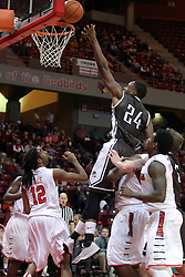 29 December 2014:  Godson Eneogwe glides through the traffic lifting the ball to the hoop during an NCAA non-conference interdivisional exhibition game between the Quincy University Hawks and the Illinois State University Redbirds at Redbird Arena in Normal Illinois.