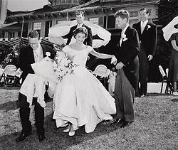John F. Kennedy, the nation's 35th President, would have turned 100 years old on May 29, 2017. With the centennial anniversary of John F. Kennedy's birth, the former president's legacy is being celebrated across the nation. PICTURED: File Photo - Newlyweds John and Jacqueline Kennedy with Jackie playfully descending a small hill at Hammersmith Farm after taking wedding party photos, with a young Ted Kennedy looking on in the background. In very fine museum-quality condition. John and Jacqueline married at historic St. Mary's Church in Newport, Rhode Island, on September 12, 1953. An iconic image of the future first lady and arguably the most publicized photograph from their wedding.. In commemoration of JFK's 100th birthday on May 29, 2017, RR Auction has curated an once-in-a-lifetime assortment of Kennedy artifacts, signed material, and photographs to celebrate the life of America's beloved 35th president. The more than 175 lots cover; JFK's early years, the transition to his congressional and senatorial careers, and 'The 1,000 Days of Camelot,' Kennedy's storied tenure as president. The special online offering is scheduled to begin on May 11 and will conclude on May 18, 2017. The R. Paloger photographs depict a fascinating and crucial period in JFK's life from 1946