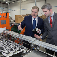 Terry Fox CEO CupPrint shows Minister of State for Trade, Employment, Business, EU Digital Single Market and Data Protection Pat Breen the Production line at CupPrint, Ennis