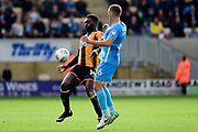 Cambridge United striker Jabo Ibehre (14) battles for possession with Coventry City midfielder Liam Kelly (6) during the EFL Sky Bet League 2 match between Cambridge United and Coventry City at the Cambs Glass Stadium, Cambridge, England on 16 September 2017. Photo by Dennis Goodwin.