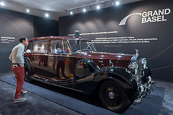 © Licensed to London News Pictures. 28/06/2018. LONDON, UK. A visitor views a Rolls Royce Phantom Four, one of 18 that exist, and owned by the Royal family. Members of the public visit Masterpiece London, the world's leading cross-collecting art fair held in the grounds of the Royal Hospital Chelsea.  The fair brings together 160 international exhibitors presenting works from antiquity to the present day and runs 28 June to 4 July 2018.  Photo credit: Stephen Chung/LNP
