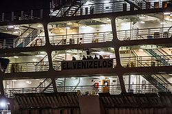 """People wearing a protective face mask on Greek ferry """"Eleftherios Venizelos"""" docked at Pireaus port under quarantine on April 3, 2020, after authorities found 119 of its 383 passengers infected with covid-19. - The ferry is carrying a 34-person crew and another 349 seamen of various nationalities, among them two Greek citizens. <br /> <br /> Pictured: <br /> Dimitris Lampropoulos  