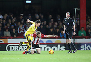 Burnley midfielder Joey Barton fouling Brentford midfielder Alan Judge in front of ref during the Sky Bet Championship match between Brentford and Burnley at Griffin Park, London, England on 15 January 2016. Photo by Matthew Redman.