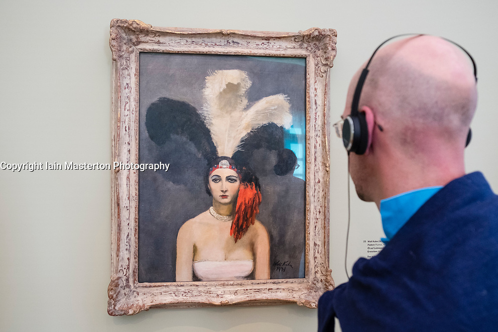 Man looking at painting Plumes by Walt Kuhn at exhibition of American art , From Hopper to Rothko at the Barberini Museum in Potsdam , Germany . Editorial Use Only