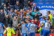 Kilmarnock fans celebrate as Stuart Findlay (#17) of Kilmarnock FC scores a goal and runs to the fans during the Ladbrokes Scottish Premiership match between Heart of Midlothian and Kilmarnock at Tynecastle Stadium, Gorgie, Scotland on 4 May 2019.