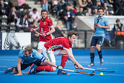 Canterbury's Tom Bean is tackled by Dan Shingles of Reading. Canterbury v Reading - Men's Cup Final, Lee Valley Hockey & Tennis Centre, London, UK on 29 April 2017. Photo: Simon Parker