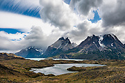 Beyond Laguna Larga rise Los Cuernos (The Horns) above blue-green Nordenskjöld Lake, in Torres del Paine National Park, Ultima Esperanza Province, Chile, Patagonia, South America. The Park is listed as a World Biosphere Reserve by UNESCO. This image was stitched from multiple overlapping photos.
