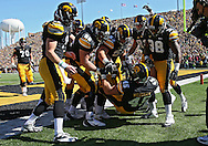 September 22 2012: Iowa Hawkeyes fullback Mark Weisman (45) is greeted by his teammates after his 34 yard touchdown run during the first half of the NCAA football game between the Central Michigan Chippewas and the Iowa Hawkeyes at Kinnick Stadium in Iowa City, Iowa on Saturday September 22, 2012. Central Michigan defeated Iowa 32-31.