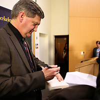 "Reporter James Risen signs a copy of his book after speaking at the ""Prosecuting the Press"" event at the UC Berkeley Graduate School of Journalism in Berkeley, California, on Thursday, November 14, 2013. Risen, the New York Times national security reporter is facing jail for refusing to comply with a subpoena to reveal his sources in relation to his book titled State of War: The Secret History of the CIA and the Bush Administration. (AP Photo/Alex Menendez)"