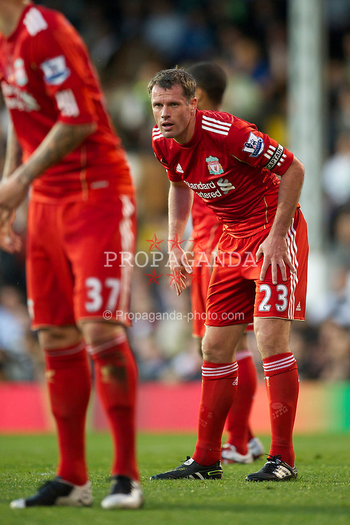 LONDON, ENGLAND - Monday, May 9, 2011: Liverpool's Jamie Carragher, making his 666th appearance for the club, in action against Fulham during the Premiership match at Craven Cottage. (Photo by David Rawcliffe/Propaganda)