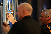 Wayne Jones collects his darts during the World Championship Darts 2018 at Alexandra Palace, London, United Kingdom on 17 December 2018.