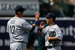 OAKLAND, CA - MAY 04: Dae-Ho Lee #10 of the Seattle Mariners celebrates with Norichika Aoki #8 after the game against the Oakland Athletics at the Oakland Coliseum on May 4, 2016 in Oakland, California. The Seattle Mariners defeated the Oakland Athletics 9-8. (Photo by Jason O. Watson/Getty Images) *** Local Caption *** Dae-Ho Lee; Norichika Aoki