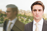 Businessman by reflection in window head and shoulders
