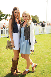 Left to right, AMBER LE BON and TALLY CARLING at the Cartier International Polo at Guards Polo Club, Windsor Great Park, Berkshire on 25th July 2010.