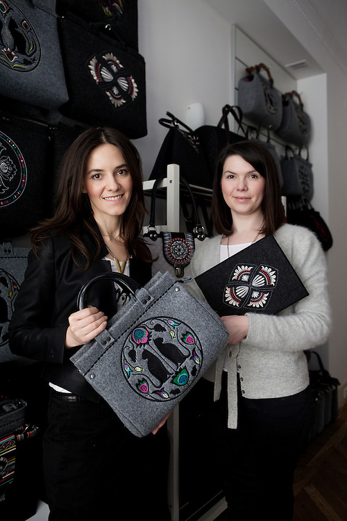 Warsaw, Poland, march 14th 2013. Malgorzata Kotlonek and Agnieszka Kotlonek-Wojcik, founders and owners of Goshico, unique brand on the Polish market combining contemporary design with folk motifs. In 2008 Goshico launched the collection for embroidered felt bags, large cut-out ornaments inspired by folk design typical from the region of Lowicz. Since then, Goshico it has become a combination of trademark..Collections are inspired by folk design, each of which however comes to the subject in a different way. Handbags are decorated in a unique characteristic of climate. Previous collections were inspired ?owickimi designs, Kashubian, Greek terracotta, mosaics and even Persian. Cross-section of black embroidery to the neon colored patterns proves that felt and folk influences are for all - businesswoman, fashionistas, young mothers and teenagers..All Goshico products are manufactured to the highest standards of Polish production. Handbags are hand-cut and sewn embroidery are very thick and convex, wykorzystyjemy only high-quality materials...Creating collections behave roles. Ma?go designs, and the Aga layer takes care of the organization, performance and quality products. Perfectly complement each other by combining two completely different characters and ways of being. For many years, the same szy?y?my our bags, now replaces our carefully selected small team. Together we strive to create for you a unique handicraft.