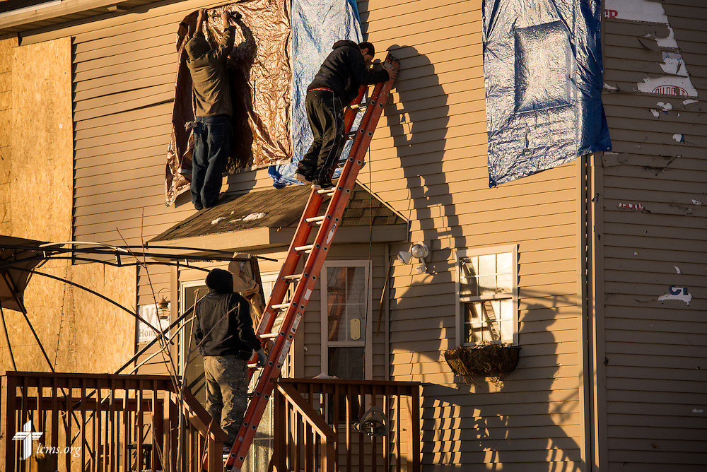 Workers repair a home damaged by tornadoes in Washington, Ill., on Wednesday, Dec. 18, 2013. Nearly two dozen tornadoes plowed through Illinois in November, killing a total of seven. LCMS Communications/Erik M. Lunsford