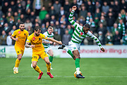 Oliver Ntcham (#21) of Celtic FC  gets to the ball ahead of Keaghan Jacobs (#7) of Livingston FC during the Ladbrokes Scottish Premiership match between Livingston FC and Celtic FC at The Tony Macaroni Arena, Livingston, Scotland on 6 October 2019.