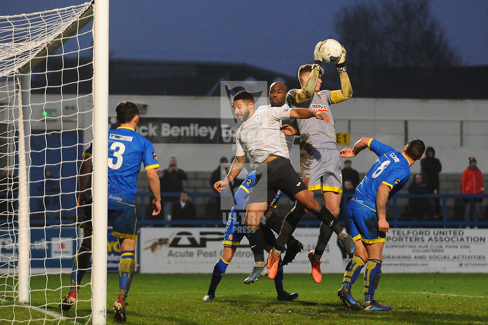 TELFORD COPYRIGHT MIKE SHERIDAN Alfreton keeper Jordan Wright claims from Ellis Deeney of Telford  during the Vanarama Conference North fixture between AFC Telford United and Alfreton Town at the New Bucks Head Stadium on Thursday, December 26, 2019.<br /> <br /> Picture credit: Mike Sheridan/Ultrapress<br /> <br /> MS201920-036