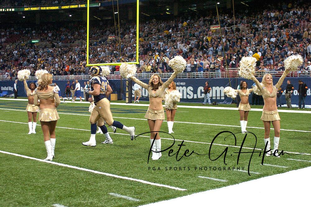 The St. Louis Rams Cheerleaders line the field as the Rams enter the field before playing Seattle at the Edward Jones Dome in St. Louis, Missouri, October 9, 2005.  The Seahawks beat the Rams 37-31.