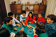 Teens at a party play cards. Santiago, Chile.