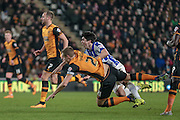 Michael Dawson (c) (Hull City) brings down fernando Forestieri (Sheffield Wednesday) just outside the box for a free kick during the Sky Bet Championship match between Hull City and Sheffield Wednesday at the KC Stadium, Kingston upon Hull, England on 26 February 2016. Photo by Mark P Doherty.