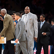 January 9, 2018, New York, NY : Georgetown head coach Patrick Ewing, in grey suit at center, breaks after a time out during Tuesday night's matchup between the Hoyas and Red Storm at the Garden. In something of a rematch of their 1985 contest, Basketball greats Patrick Ewing and Chris Mullin returned to Madison Square Garden on Tuesday night to face off as coaches with their respective Georgetown and St. John's teams.  CREDIT: Karsten Moran for The New York Times
