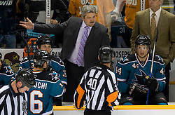 April 22, 2010; San Jose, CA, USA; San Jose Sharks head coach Todd McLellan (top) talks to an NHL official during the second period of game five in the first round of the 2010 Stanley Cup Playoffs against the Colorado Avalanche at HP Pavilion.  San Jose defeated Colorado 5-0. Mandatory Credit: Jason O. Watson / US PRESSWIRE