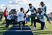 Philadelphia Eagles player interact with the kids at the flag event during the press, training and media day for Philadephia Eagles at London Irish Training Ground, Hazelwood Centre, United Kingdom on 26 October 2018. Picture by Jason Brown.