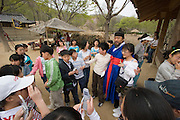 Korean Folk Village. TV movie set. Kids taking souvenir photos with famous TV actor Kim Ho-Kun.