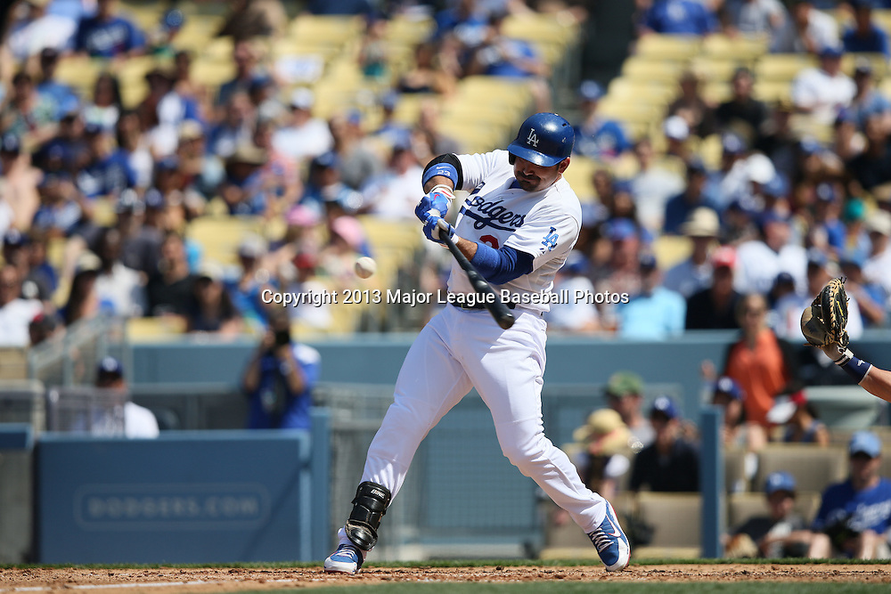 LOS ANGELES, CA - APRIL 28:  Adrian Gonzalez #23 of the Los Angeles Dodgers bats during the game against the Milwaukee Brewers on Sunday, April 28, 2013 at Dodger Stadium in Los Angeles, California. The Dodgers won the game 2-0. (Photo by Paul Spinelli/MLB Photos via Getty Images) *** Local Caption *** Adrian Gonzalez