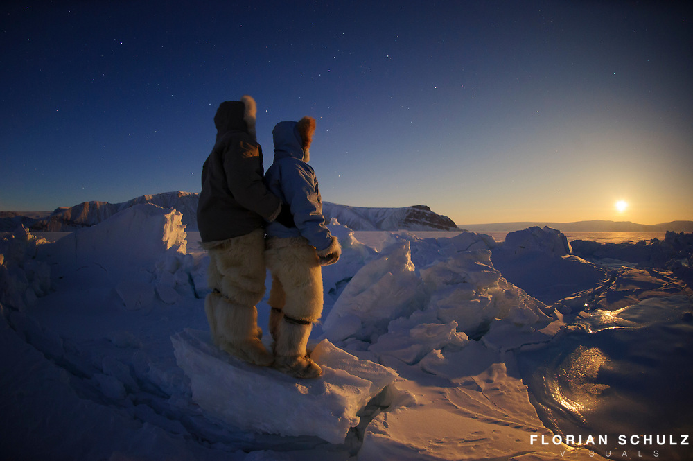In Greenland, as the moon rises, Florian and his wife, Emil, are kept<br /> warm by traditional polar bear clothing provided by their Native hosts.