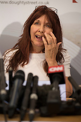 © licensed to London News Pictures. London, UK 16/10/2012. Janis Sharp talking at a press conference at Doughty Street Chambers, London after British computer hacker Gary McKinnon wins his fight against extradition to the US, Home Secretary. Photo credit: Tolga Akmen/LNP