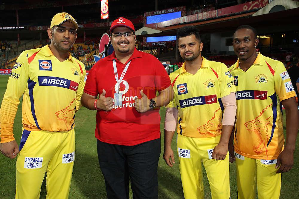 Chennai Super Kings Captain MS Dhoni, the Vodafone Superfan, Suresh Raina of Chennai Super Kings and Dwayne Bravo of Chennai Super Kings during match 20 of the Pepsi IPL 2015 (Indian Premier League) between The Royal Challengers Bangalore and The Chennai Superkings held at the M. Chinnaswamy Stadium in Bengaluru, India on the 22nd April 2015.<br /> <br /> Photo by:  Shaun Roy / SPORTZPICS / IPL