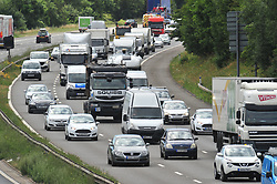 July 21, 2017 - M25 J3 Swanley, Kent, UK - Traffic QUEUE HELL on the M25 all afternoon..THE BACK OF THE QUEUING TRAFFIC Anti-clock wise at Junction 3 for Swanley Kent.. Traffic is at a near standstill as the summer holiday getaway madness begins as the schools break up for the summer. (Credit Image: © Grant Falvey/London News Pictures via ZUMA Wire)