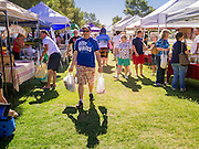 "09 JUNE 2012 - PHOENIX, AZ: People walk through the Roadrunner Farmers' Market. The Roadrunner Farmer's Market, in Roadrunner Park in Phoenix, is one of the most popular farmers' markets in the Phoenix area. Unlike many of the other farmers' markets, it's open year round. Most of the vendors in the market are local small scale farmers who practice sustainable agriculture. The market is very popular with ""locavores,"" people interested in eating food that is locally produced and not moved long distances to market.    PHOTO BY JACK KURTZ"