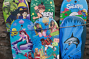 "Bodyboards on sale in the north Devon coastal village of Combe Martin. The bodyboard differs from a surfboard in the fact that it is much shorter and made out of foam. Bodyboarding has been around since ancient Hawaiian days, it was called ""Paipo"" and was made out of koa wood. The modern board consists of a foam 'core' encapsulated by a plastic bottom and a softer foam top known as the deck. The core is made up from dow/polyethylene, arcel or, more recently, polypropylene."