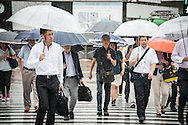 People walking under the rain. Typhoon number 10 called Lionrock hit japan early on morning, in Tokyo. 30/08/2016-Tokyo, JAPAN