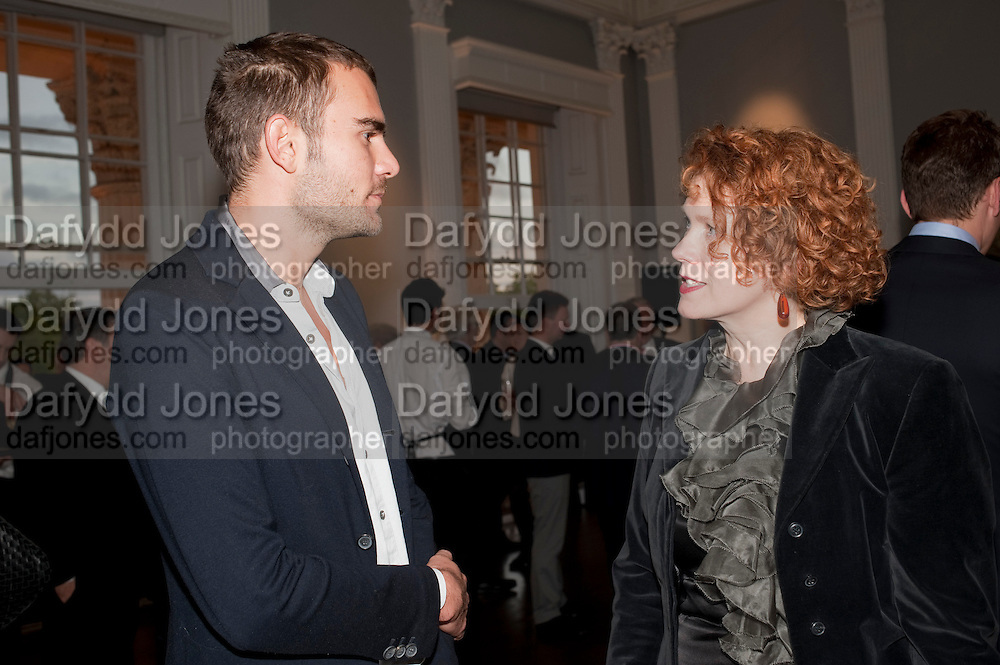 OSCAR HUMPHRIES; ANN MACGREGOR, MCA Sydney cocktails. Brandon rooms. ICA. London. 11 October 2011. <br /> <br />  , -DO NOT ARCHIVE-&copy; Copyright Photograph by Dafydd Jones. 248 Clapham Rd. London SW9 0PZ. Tel 0207 820 0771. www.dafjones.com.