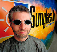corporate portrait on location,by miami photographer,matthew pace,man with sunglasses john watson,ceo sunglasshut