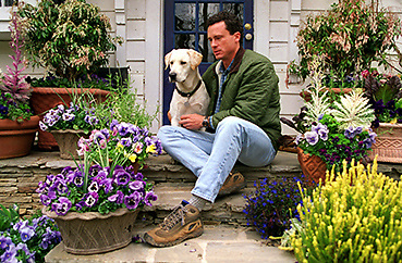 980303 ATLANTA, GA: David Ellis sits with his dog Amos in Ellis's small intown garden on March 3, 1998. (AJC Staff Photo/Phil Skinner)
