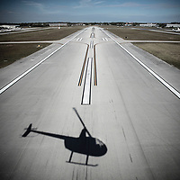 Flying low over airport runways in a hellicopter during take-off.