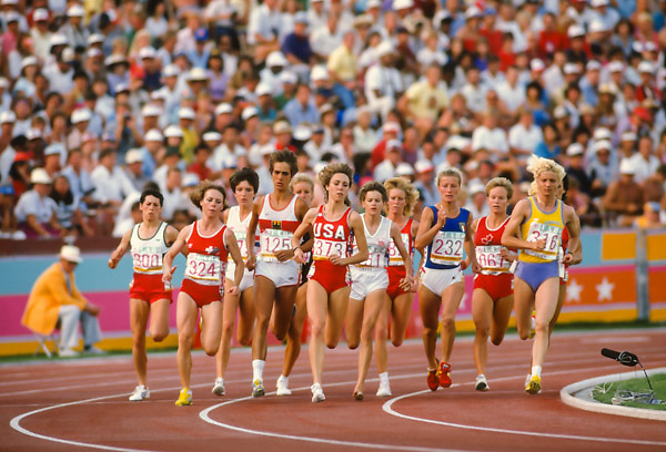 LOS ANGELES -  AUGUST 10:  L-R Aurora Cunha #300 (POR), Comelia Buerki #324 (SUI), Wendy Sly #175 (GBR), Brigitte Kraus #135 (FRG), Mary Decker #373 (USA), Zola Budd #151 (GBR), Lynn Williams #067 (CAN), Agnese Possamai #232 (ITA), Maricica Puica #316 (ROM) run the Women's 3000 meter final of the 1984 Olympics held in the Los Angeles Memorial Coliseum in Los Angeles, California on August 10, 1984. Visible behind Budd is Joan Hansen (USA).  (Photo by David Madison/Getty Images) *** Local Caption *** Aurora Cunha;Comelia Buerki;Brigitte Kraus;Mary Decker;Zola Budd,Joan Hansen;Agnese Possamai;Lynn Williams;Maricica Puica