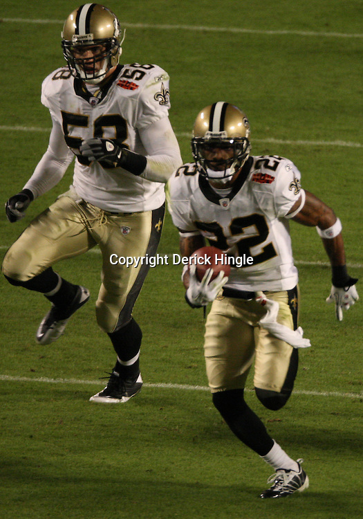 Feb 07, 2010; Miami Gardens, FL, USA; New Orleans Saints cornerback Tracy Porter (22) returns an interception for a touchdown during a 31-17 win by the New Orleans Saints over the Indianapolis Colts in Super Bowl XLIV at Sun Life Stadium.  Mandatory Credit: Derick E. Hingle-US PRESSWIRE