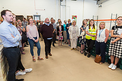 Guests listen to speeches at the opening of FareShare's relocated warehouse in Ashford, Kent. Ashford, Kent, May 23 2019.
