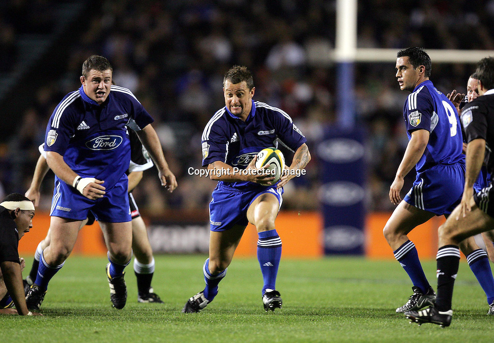 16 April 2004, Rugby Union, Rebel Sport Super 12, <br />Blues v Stormers, Eden Park, Auckland, New Zealand.<br />Carlos Spencer.<br />Stormers defeated the Blues 51-23.<br />Please credit: Andrew Cornaga/Photosport