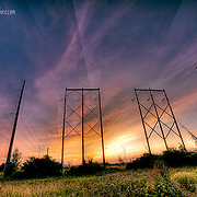 Sunrise at the East Bottoms with poles and wires in Kansas City, Missouri