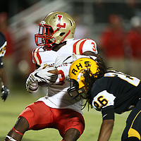 Adam Robison | BUY AT PHOTOS.DJOURNAL.COM<br /> Lafayette running back Tay Tay Owens spins off Ripley defender Shakur Hunt early in the first quarter of Firday nights match up.